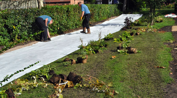 a covering to prevent weeds is laid